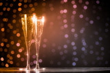 Two glasses of champagne on dark bokeh background - 121609988