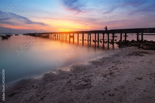 Silhouette natural background of jetty and colorful sky during time the sunset at BangPhra beach , Chonburi province in Thailand is a very popular for photographers and tourists