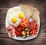 Traditional English breakfast - fried eggs, sausages, becon and - 121622944