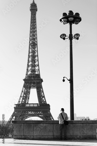 Old man tourist taking picture of Tour eiffel