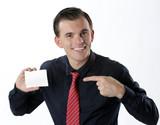 businessman holding paper visit card
