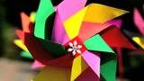 Colorful paper wind turbines are rotating