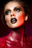 Fototapety Beautiful woman with red make up and glitter on the neck and hair