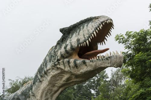 Plastic head dinosaur Allosaurus. Poster