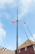 Ship's Mast.  A ship's mast with flags can be found on the waterfront at Halifax, Nova Scotia in Canada.