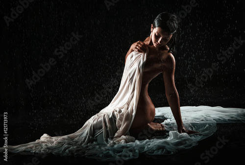 beautiful nude woman in aqua in the rain