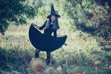 Beautiful witch in black dress