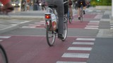 People riding on bicycle path. Bicycle path in Warsaw.