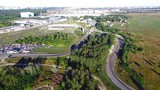 Flying over road racing track 4k aerial video. Races: off-road, on road, circuit, for motocross, bike, auto. Extreme sport concept
