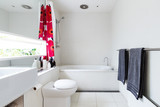 Contemporary white bathroom of mosaic and terrazzo tiles