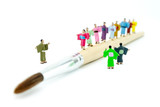 Miniature Japanese peoples walking on paintbrush