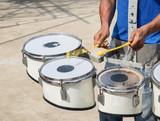 Men hitting the drum