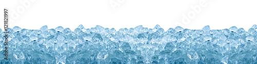 Leinwanddruck Bild crushed ice cube blue background isolated on white