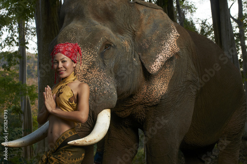 Poster Beautiful Model Posing With Live Elephant in Thailand Jungle