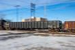Motion Blur of Freight Train Crossing Tracks