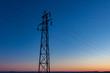 SIngle Transmission Tower against Prairie Sunset