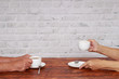 Elderly couple drink coffee after dinner