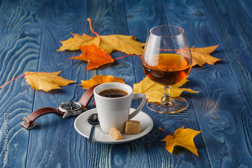 Poster Coffee and cognac on blue wood table