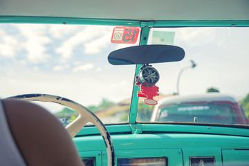 Inside a vintage classic american car in Old Havana