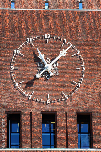 Poster large clock on City Hall (Radhuset), Oslo, Norway