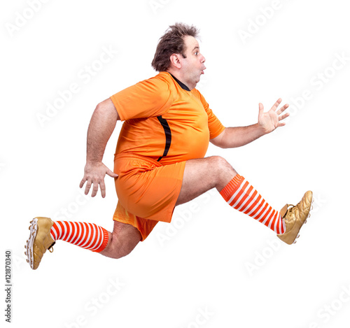 recreational footballer running isolated on a white background