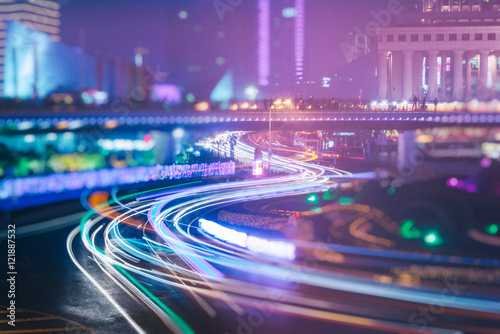 Poster traffic light trails on road,shanghai,china.