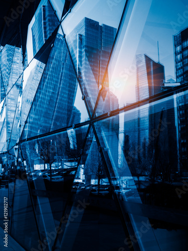 modern skyscrapers reflected on glass wall,blue toned,china. - 121902717