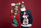 Couple with funny christmas masks. - 121903774