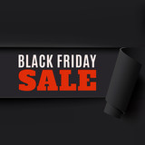 Torn Black Friday paper background.
