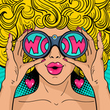 Fototapety Wow pop art face. Sexy surprised woman with blonde curly hair and open mouth holding binoculars in her hands with inscription wow in reflection. Vector background in pop art retro comic style.
