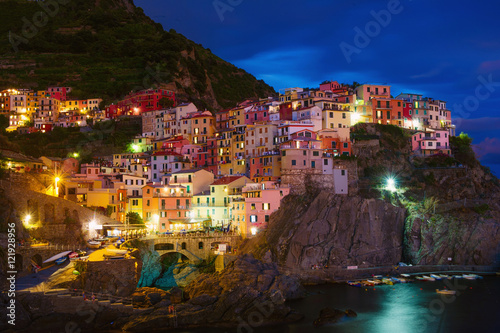 Poster Waterfront cliff town of Manarola at night, Cinque Terre, Liguria, Italy