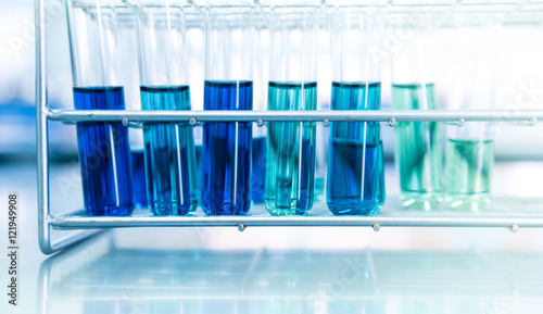 blue test tube in science laboratory background