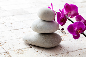symbol of mindfulness, meditation and elegance with flowers and stones
