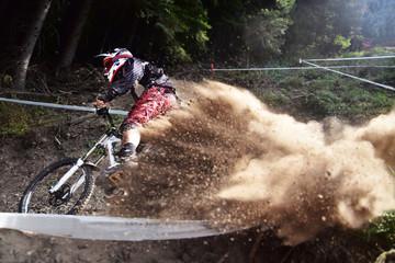 Sport race Mountain biker extreme and fun downhill track. Dirt splash. © mur162