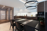 Design interior of a high tech kitchen with a  black table and chairs - 121973157