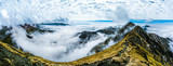 Panorama mountain ranges above the clouds. Autumn in the Romanian Carpathians
