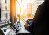 Inside a tram with driver and dashboard in sunset - 121980392