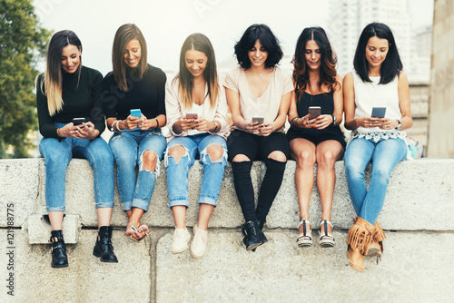 Big Group of friends using cellphones. Poster
