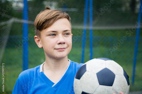 Smiling boy with a ball