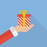 Santa hand holding christmas gift box