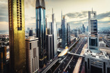 Scenic skyline of a big futuristic city with world tallest skyscrapers. Aerial view over downtown Dubai, UAE. Artistic travel and architectural background.