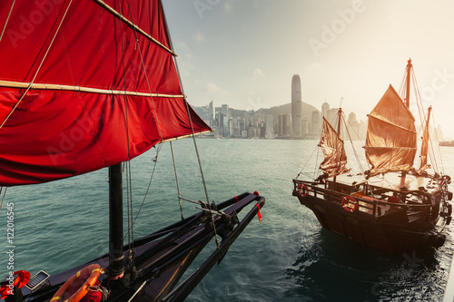 Poster, Tablou Scenic skyline of a big city with skyscrapers and traditional sailboats