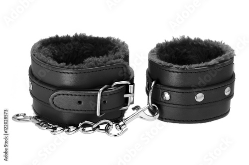 Pair of a black color leather handcuffs isolate on white background with clipping path