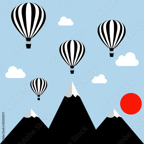 aerostats flying in the sky over the mountains at sunset - 122038571