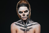 Angry young woman with gothic halloween makeup