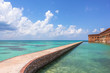 Northern Side of Fort Jefferson on Dry Tortugas National Park, Florida. Concrete Walkway around Fort Jefferson with the crystal clear waters of the Gulf of Mexico surround it.