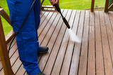 cleaning wooden terrace with high pressure washer - 122047155