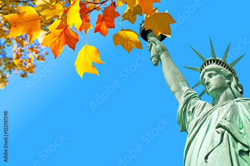 Statue of Liberty and autumnal leaves, New York,