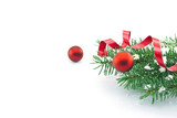Frame of Christmas tree branches with red baubles, ribbon and sn