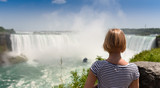 Young women looking at amazing Niagara falls. Canada Ontario